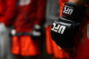 UFC glove in hand.